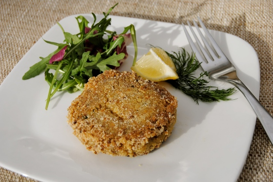 plated quinoa and smoked mackerel cake with salad