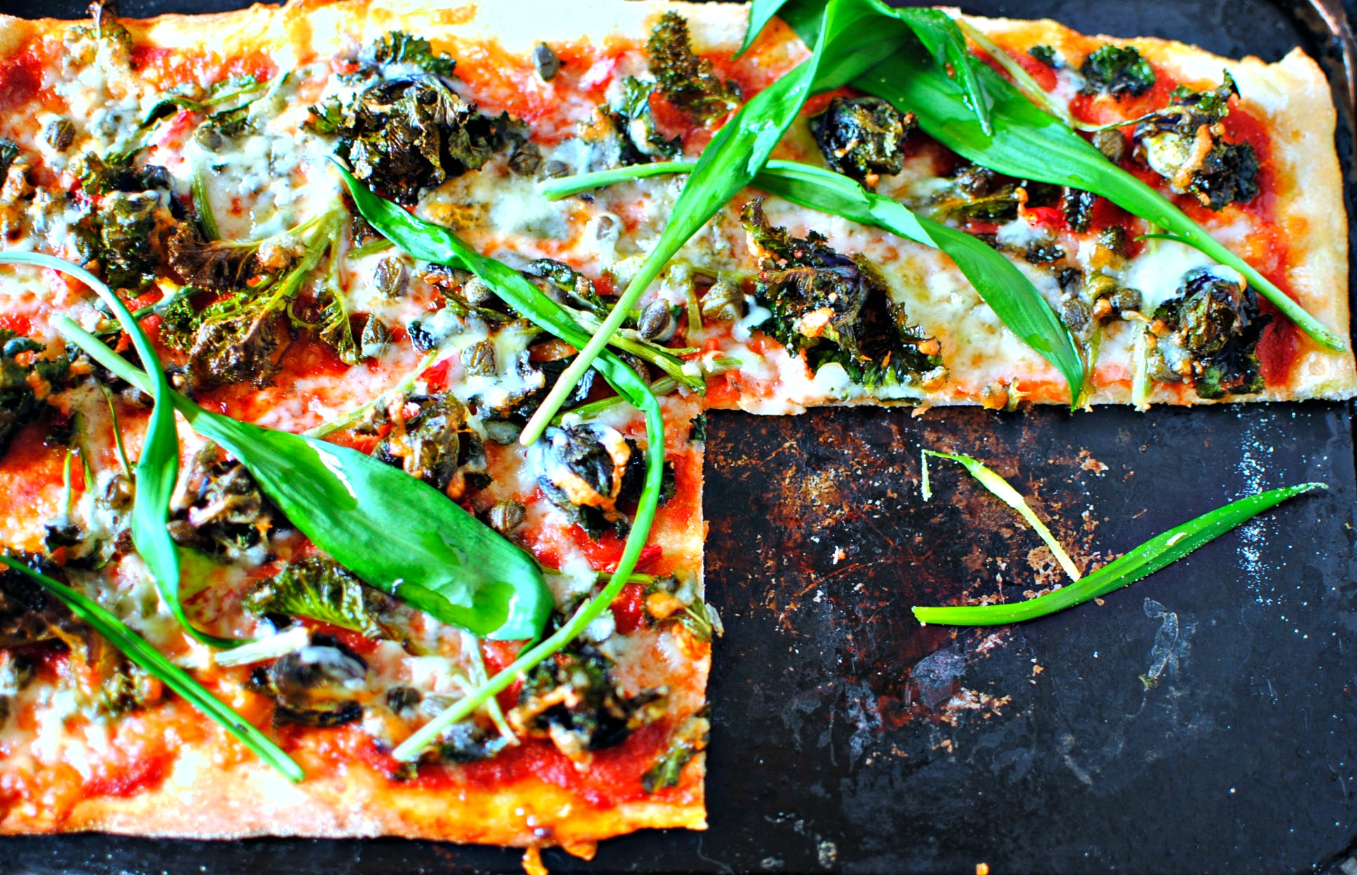 3 easy wild garlic recipes pizza pasta and pesto food to glow wild garlic pizza with kale tops capers and chilli by food to glow forumfinder Gallery