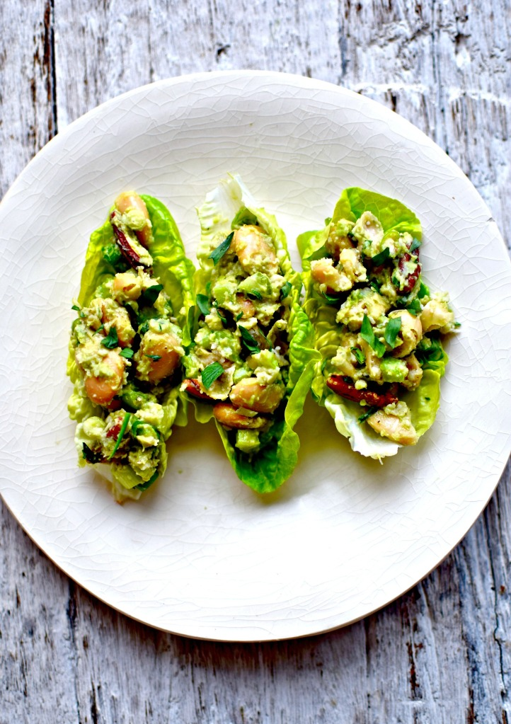 How can a recipe with no chicken and no mayo be a chicken salad? You would be surprised. White beans, avocado mayo, and the usual suspects of celery, salad onions, tarragon and nuts (in this case, pecans) give a creditable imitation without involving our cluckin' lovely feathered friends.