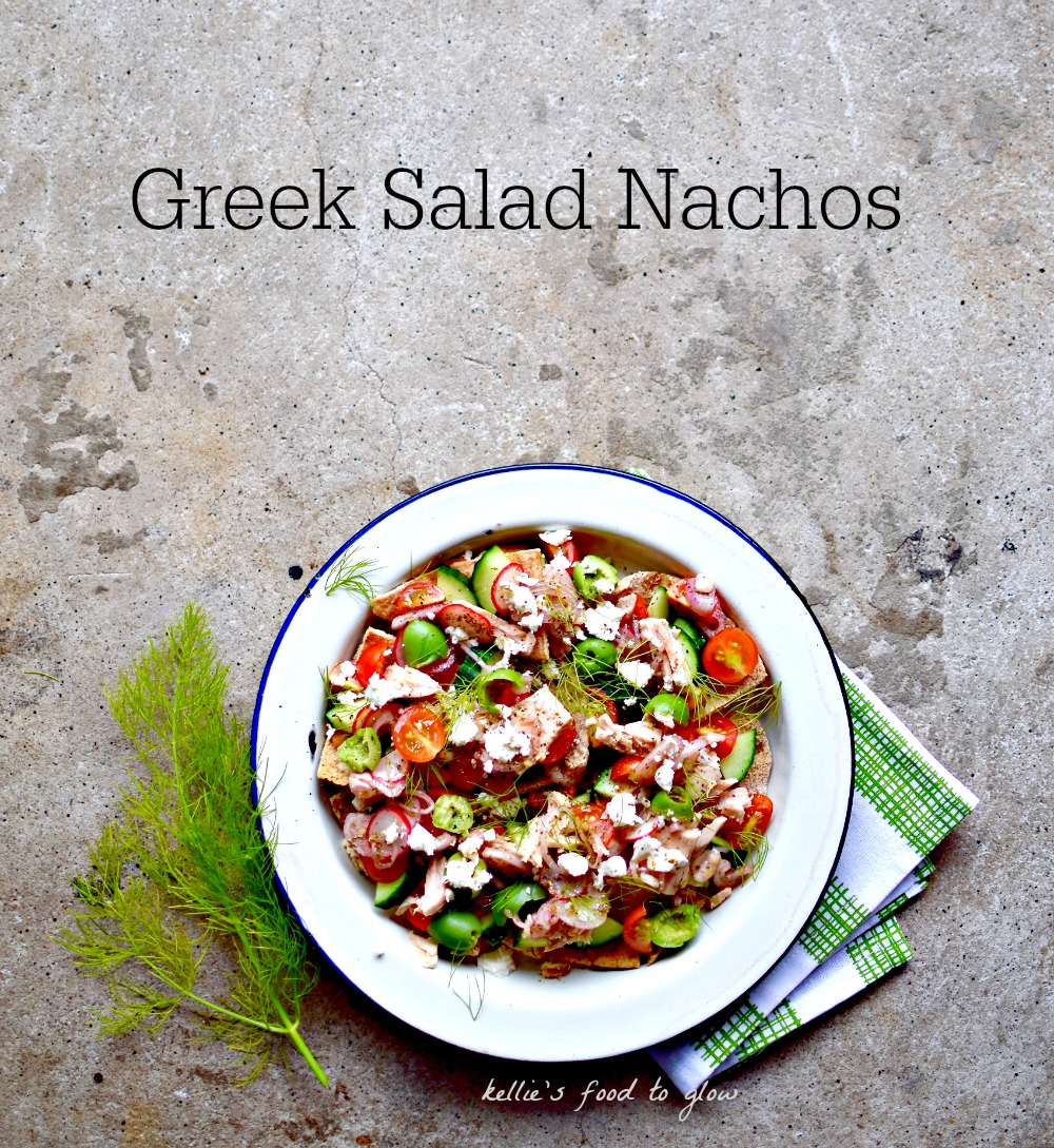 What do you do when you crave nachos AND a Greek salad? Make this crunchy plate of tangy Greek salad vegetables over crispy pitta chips, that's what. Have as a lunch or sharing snack platter.