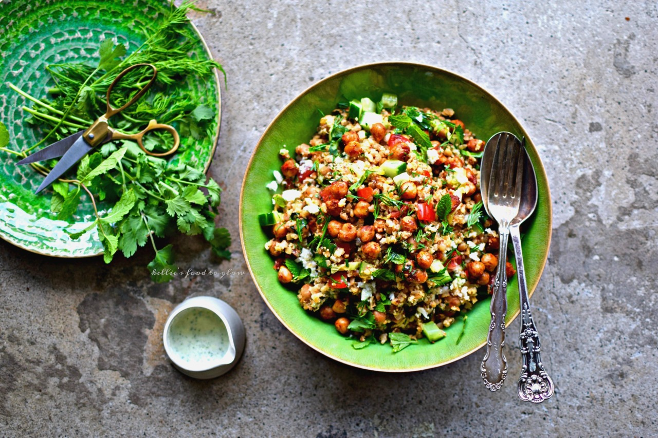 "Use your blender and one simple trick to zap whole cauliflower into perfect ""rice"" for this throw together summer tabbouleh bowl.  Add in harissa chickpeas, pre-cooked quinoa, herbs, veggies and a creamy feta and herb dressing for a cool but slightly spicy lunch or supper. Picnic-perfect and lunchbox-luscious, too."