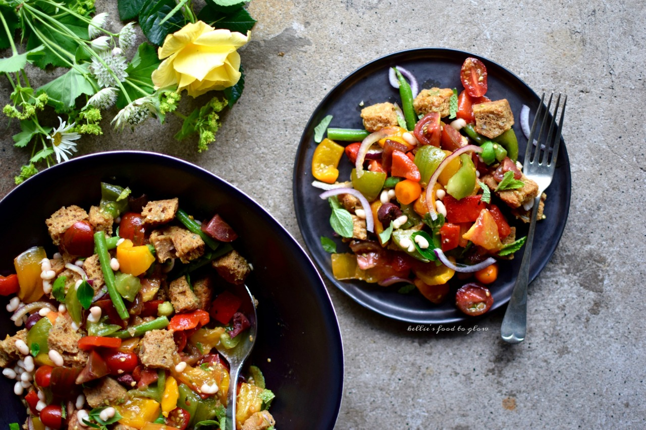 This recipe is a Greek take on the classic Italian bread and tomato salad, with loads of fresh oregano, mint and basil as well as hearty beans to make this a proper lunch or light supper. Panzanella is the ultimate picnic and lunch box salad, actually getting better as it waits. Mediterranean, colorful, and so very good for body and soul.