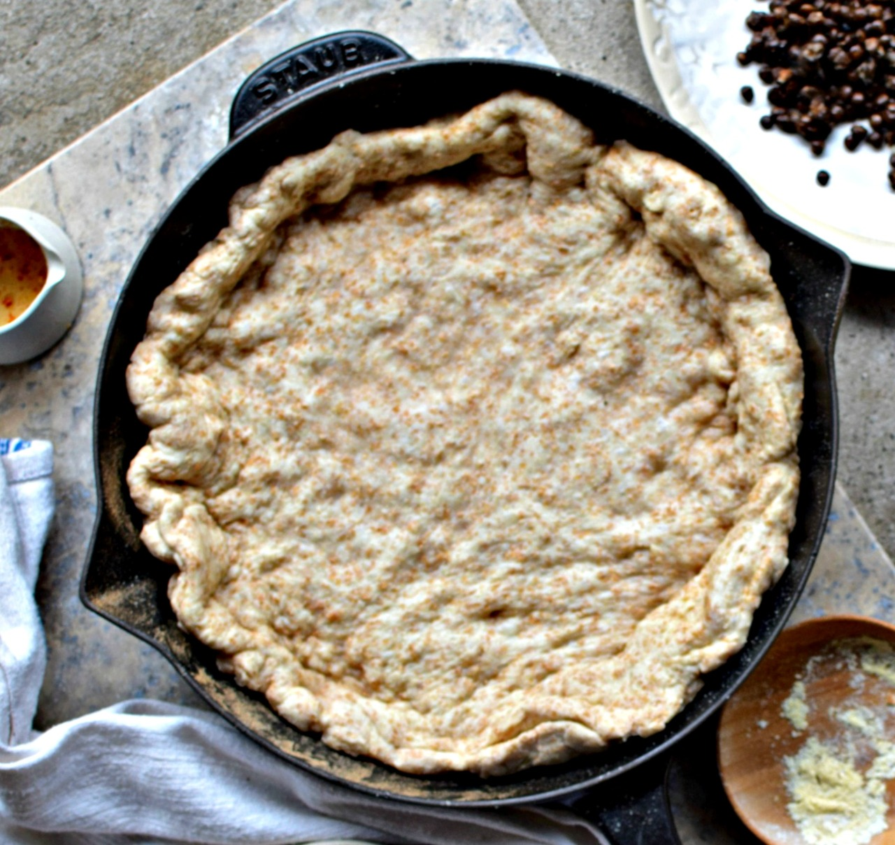 Make pizza in a cast iron skillet for a quick and healthy midweek meal that the whole family will love. Use my quick wholewheat dough - or a pre-made - and top with smoked mozzarella and cooked lentils for a delicious, vegetarian deep-dish dinner, or hearty snack. Vegan adaptations are given.