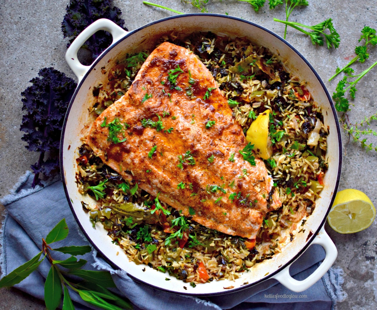 "Pearly-pink salmon kept juicy with a coating of creole spices and olive oil, cooked over vegetable-filled ""dirty"" brown rice. A healthy, family-friendly and surprisingly quick and easy recipe for a midweek dinner. Leftovers are great cold in a wrap - lettuce or grain."