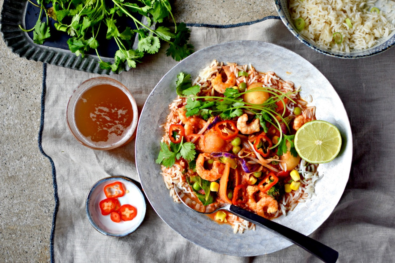 If you are toiling for a tasty midweek dinner idea, this gently spiced tomato and coconut prawn (shrimp) curry can be on your table in 15 minutes. Serve with pre-cooked rice or chapatis to keep it quick and easy.