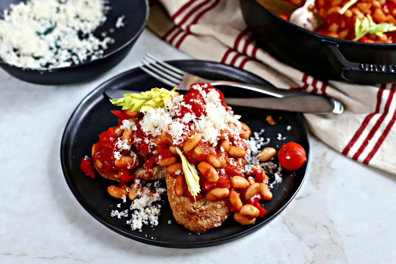Deliciously frugal Bloody Mary Baked Beans on toast make a great breakfast, brunch, lunch or dinner, especially with a golden-yoked poached egg on top.